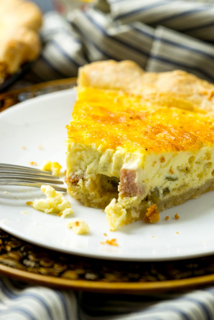 Best basic quiche recipe slice on white plate