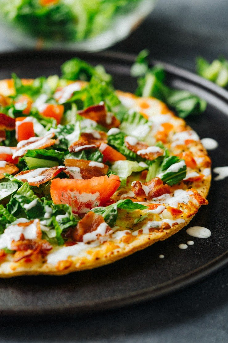I can't get enough of this BLT Margherita Pizza! It's so easy to throw together and gives pizza a light, crisp make-over for the spring and summer! A must make!
