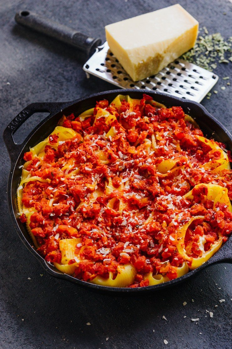 five cheese stuffed lumaconi in a cast iron skillet