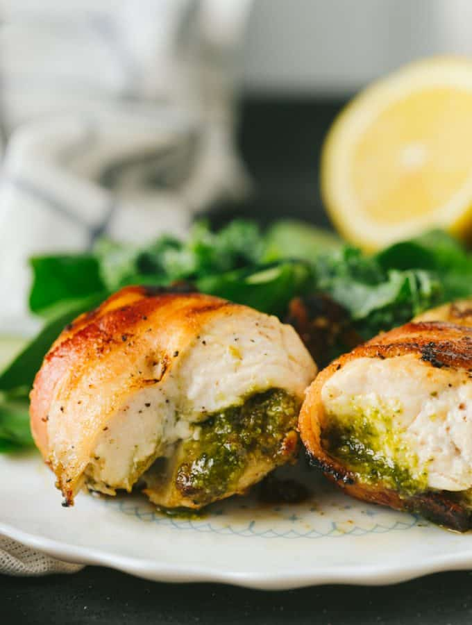 The easiest, moistest, most flavorful chicken ever! This bacon wrapped pesto chicken is packed with flavor and takes only 15 minutes to bake under the broiler. making it a perfect weeknight meal!
