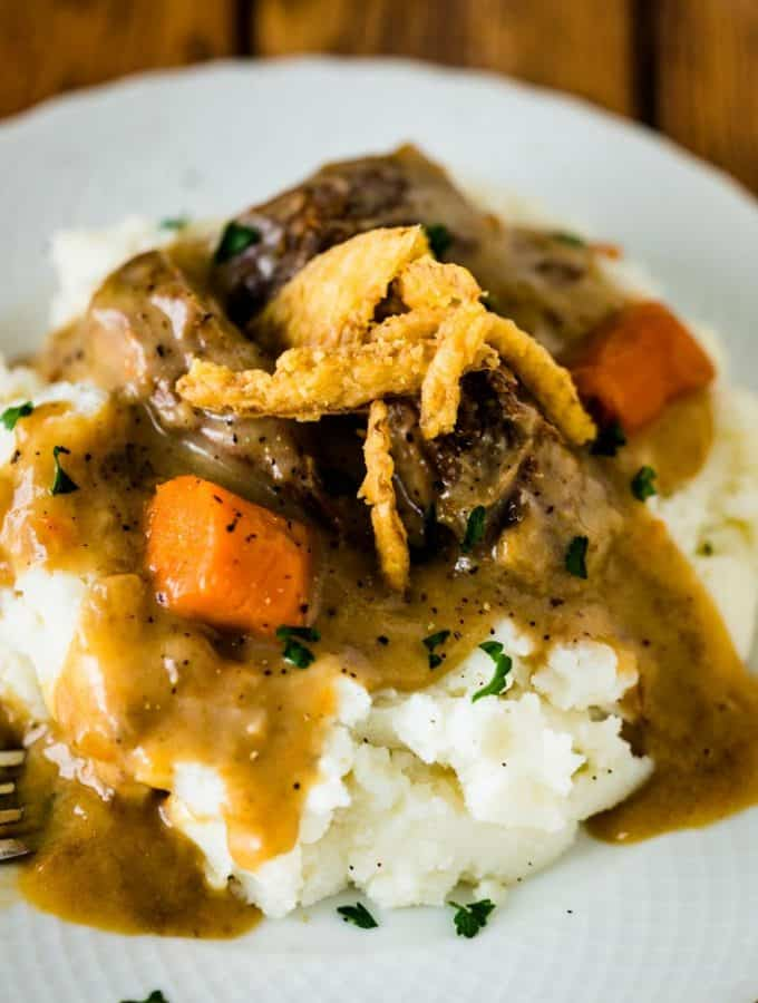 Instant Pot Pot Roast-- A Sunday dinner-worthy meal made in about an hour thanks to the Instant Pot and just a handful of ingredients.