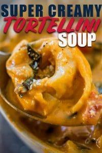 Creamy tortellini soup on spoon