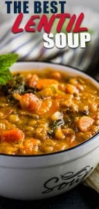The best vegetarian lentil soup in a white bowl with mint