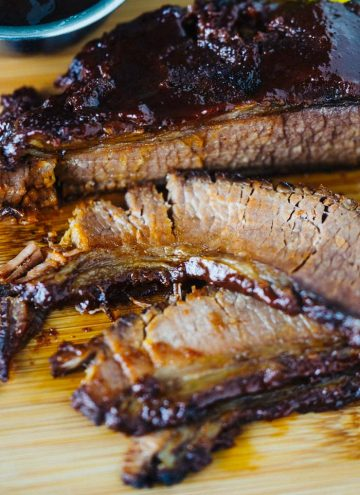 Instant Pot Beef Brisket on wood cutting board