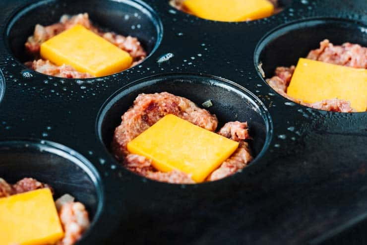 Meatloaf mix in non-stick pan with cheese slices on top