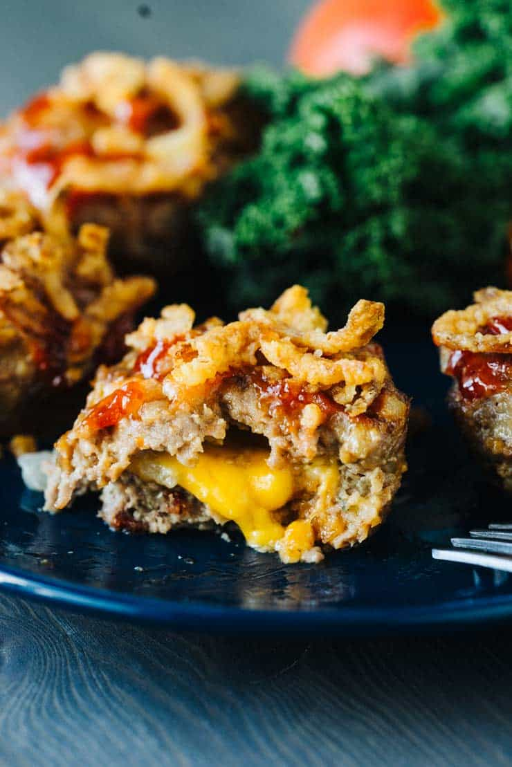 Mini Bacon Cheeseburger Meatloaf Muffins on a Blue Plate