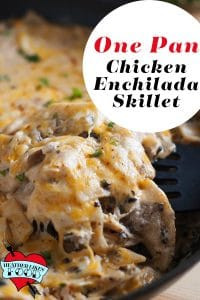 A scoop of sour cream chicken enchilada skillet
