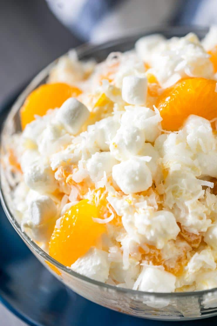 Close up of Ambrosia salad-- marshmallows, cool whip, sour cream, mandarin oranges.