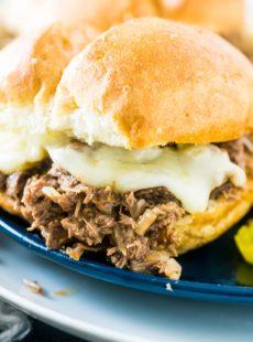 Slow Cooker Italian Beef Sandwich on blue plate