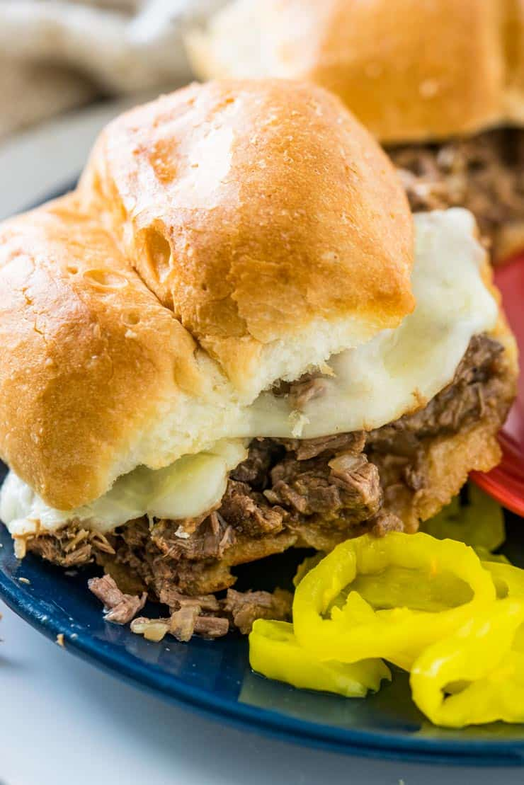 Slow Cooker Italian Beef Sandwich on blue Plate with peppers