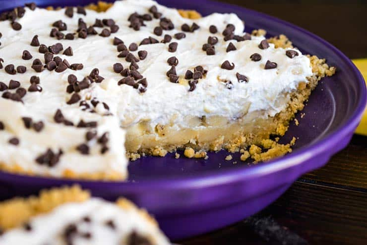Banoffee Pie with shortbread crust in a purple pie dish
