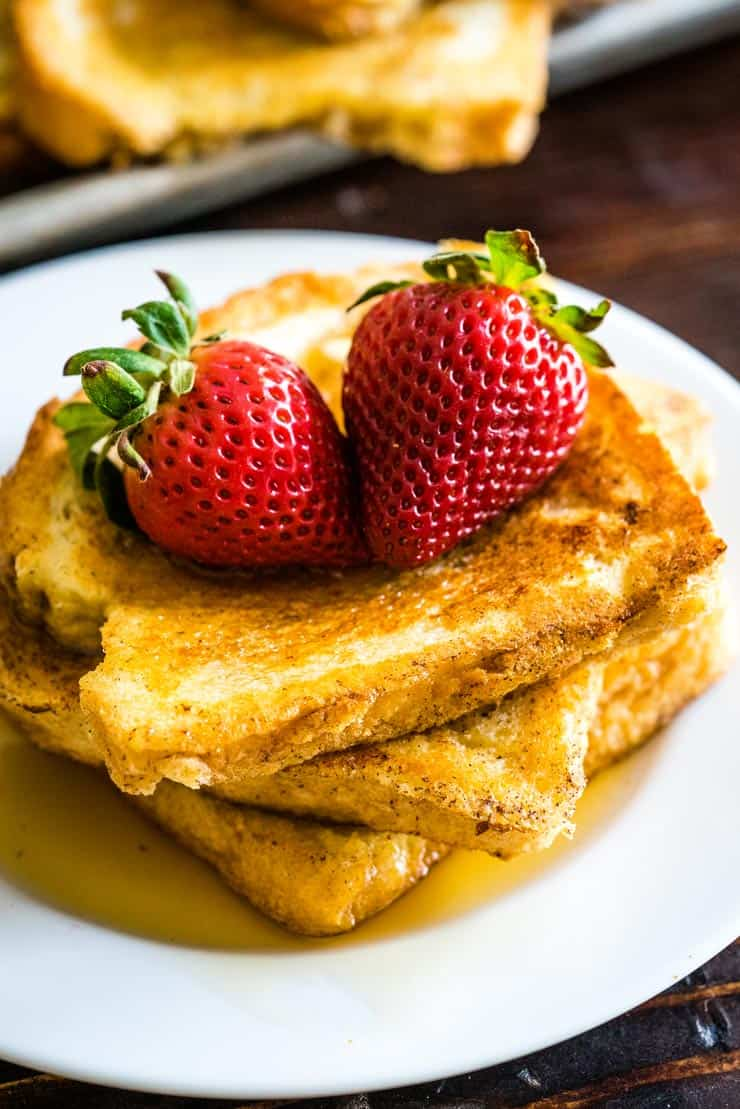 Easy French Toast on a white plate with strawberries