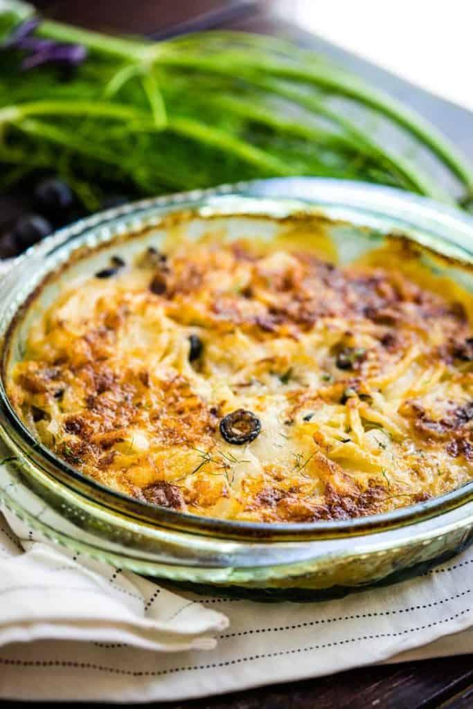 Glass Dish with potatoes au gratin inside