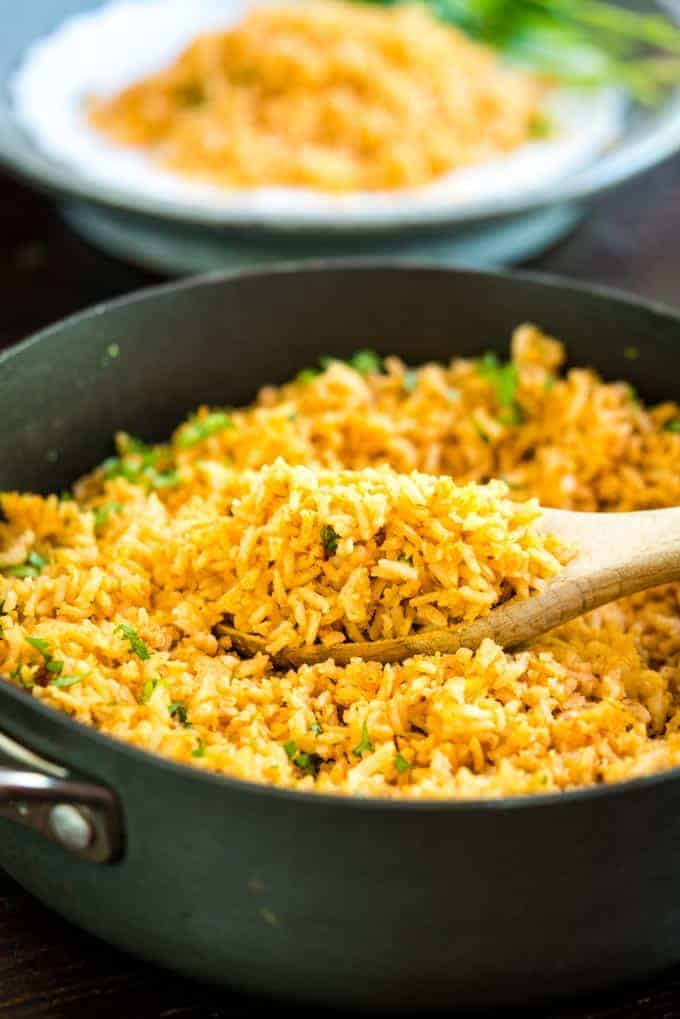 Mexican Spanish Rice in pan with wooden spoon