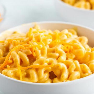 Bowl of and cheese with cheese on top