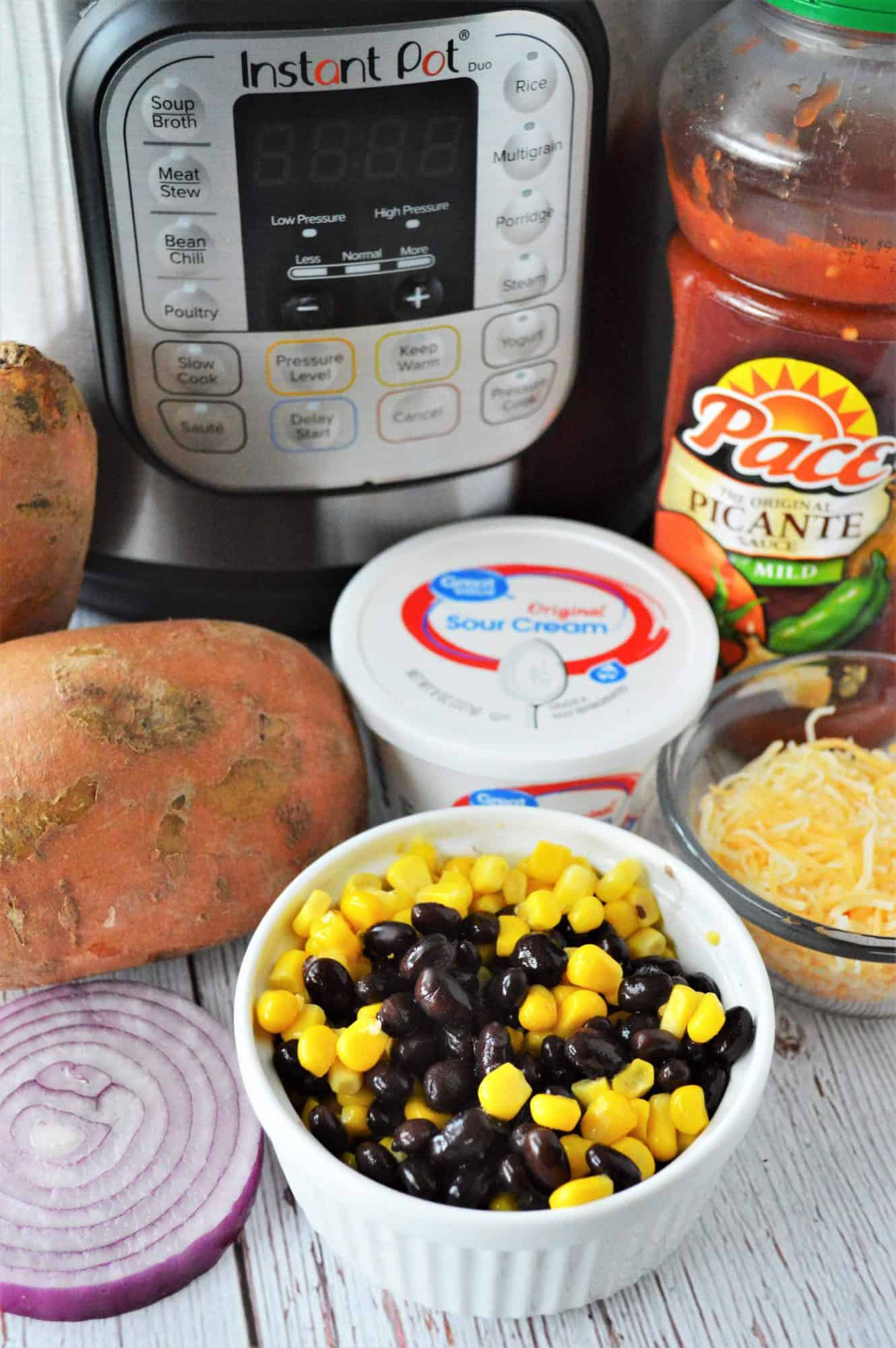 bowl of black beans and corn and other southwest flavored toppings