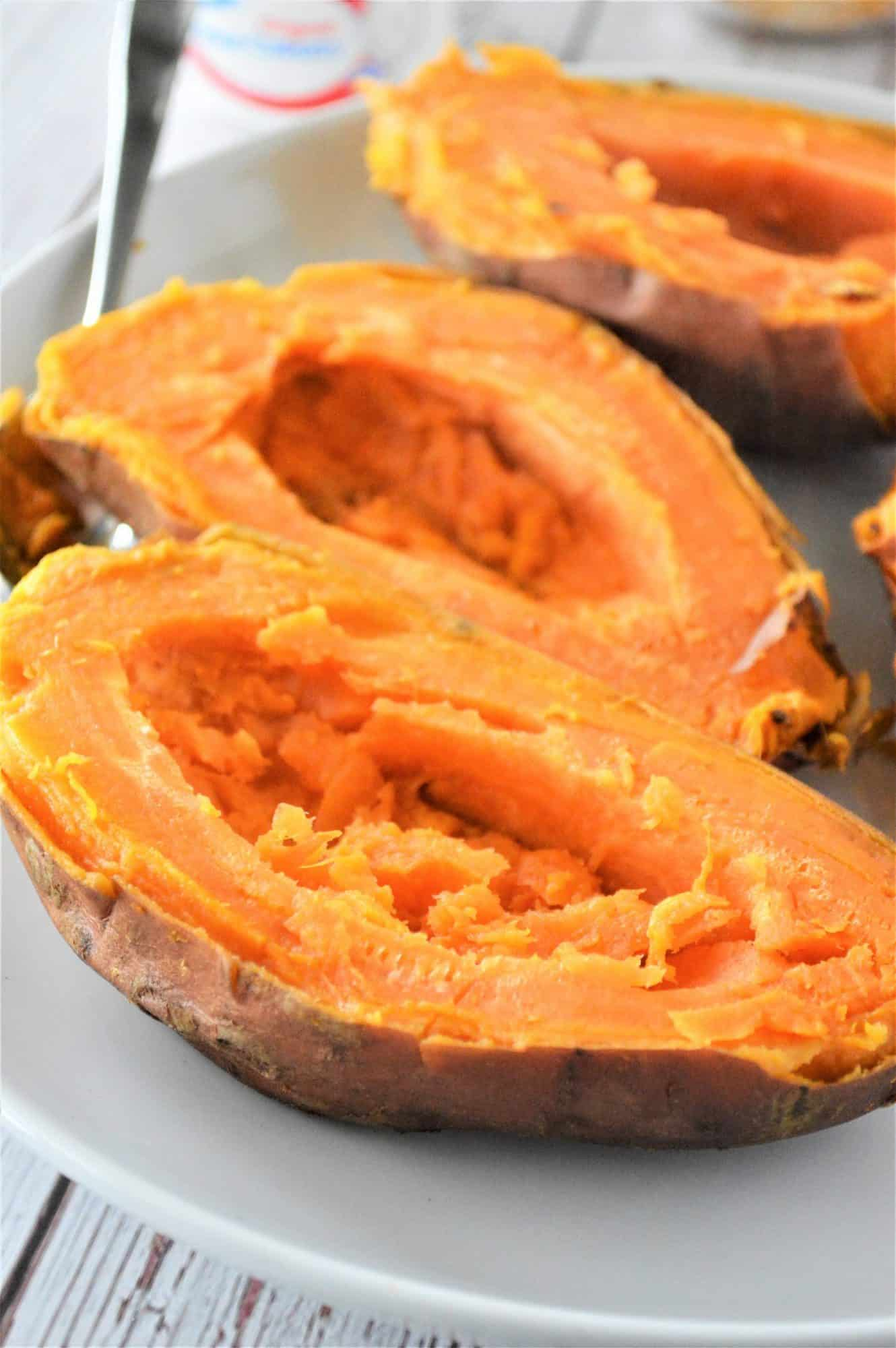 Sweet potatoes cut in half with the middles scooped out