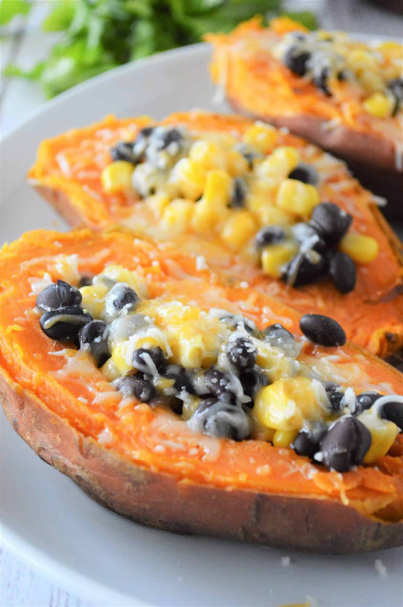 Sweet potato halves stuffed with black beans, corn and cheese
