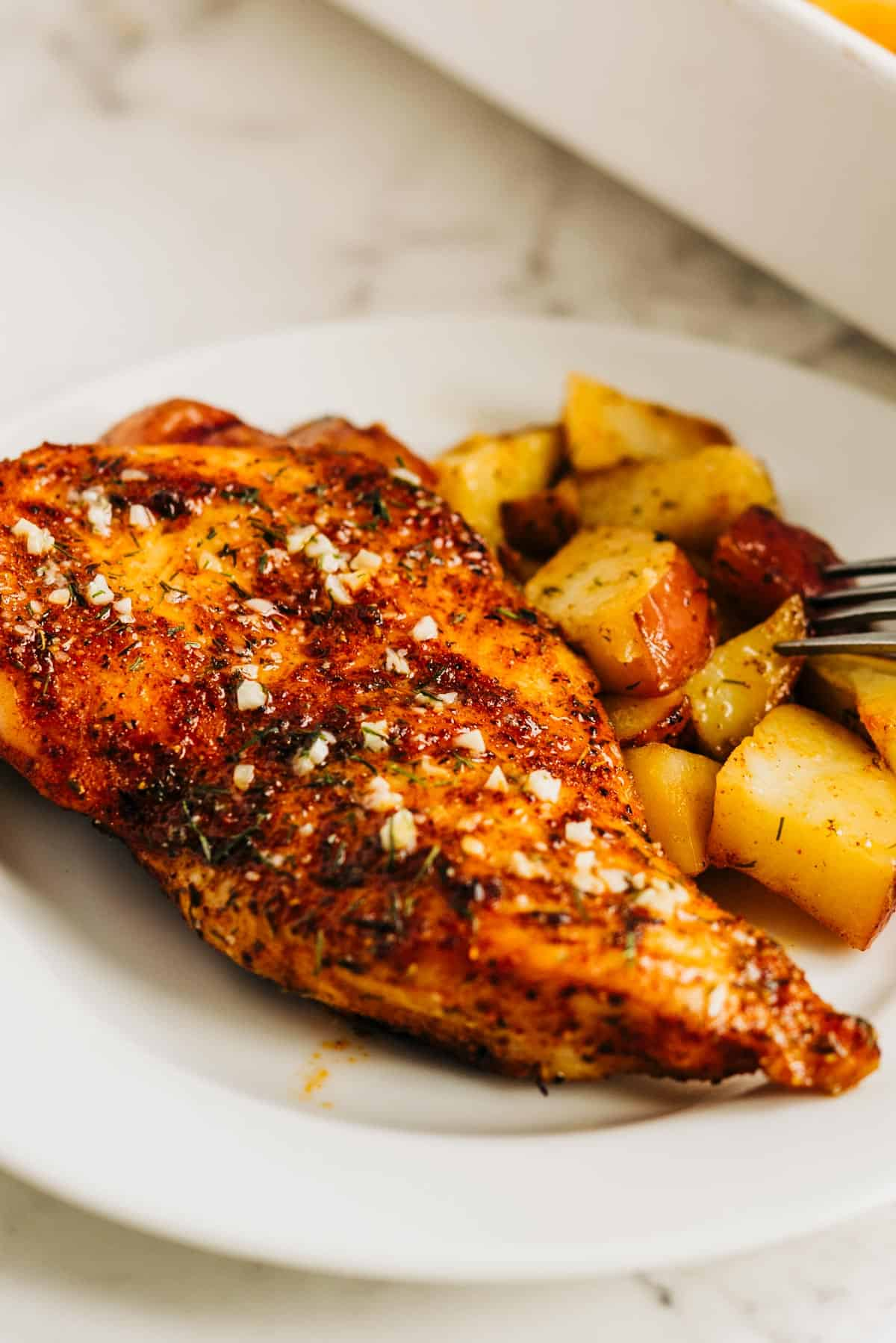 Baked chicken breast on a white plate