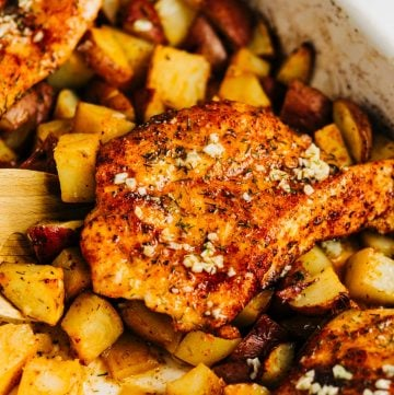 Garlic chicken and potatoes in a white dish