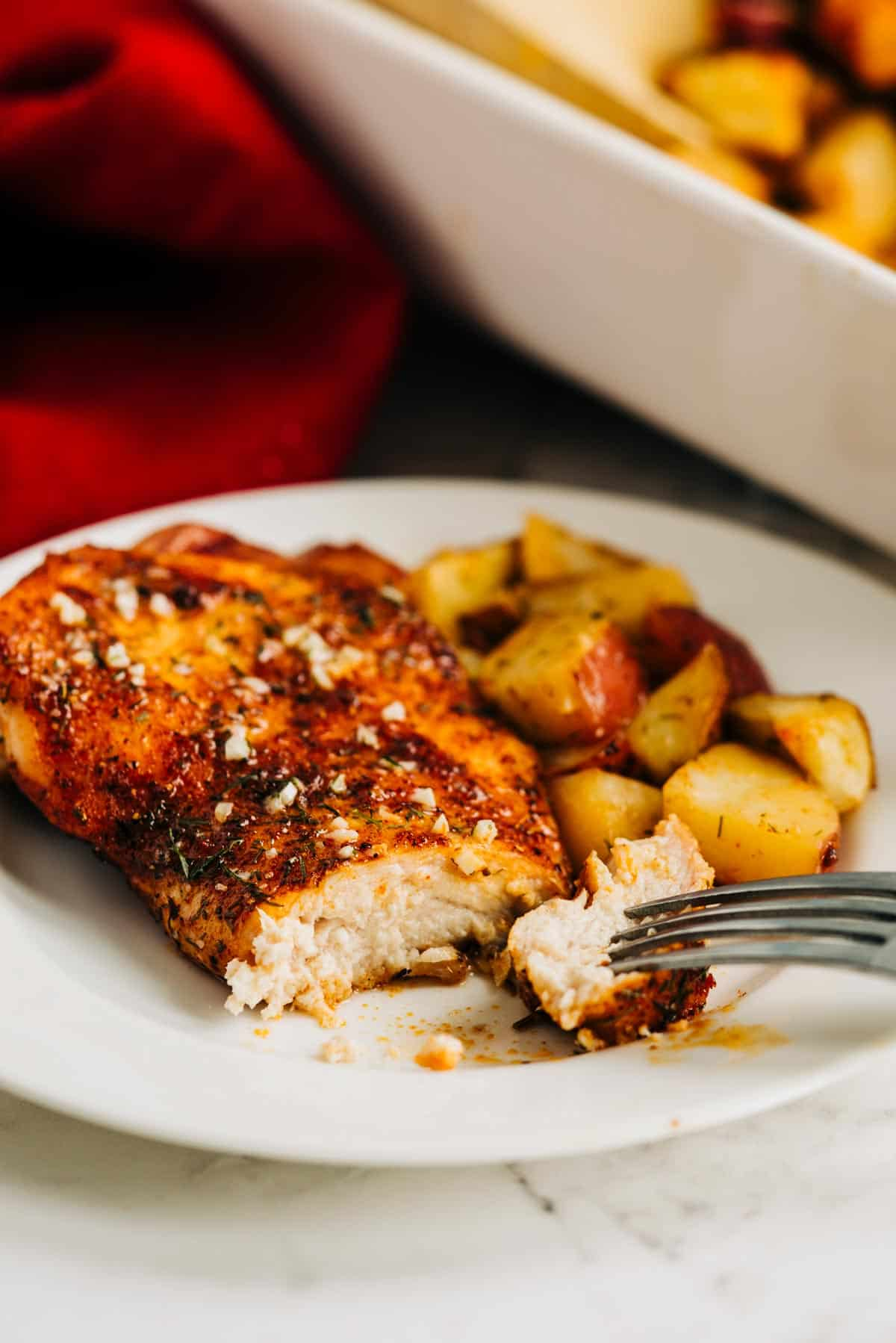 Chicken breast on a plate with a bite cut out