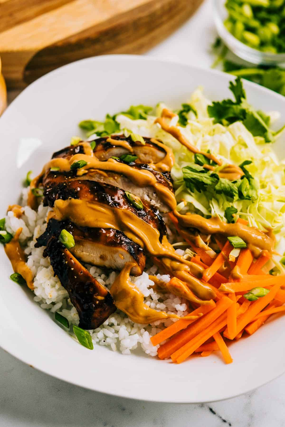 Thai Chicken Bowl with rice and peanut sauce