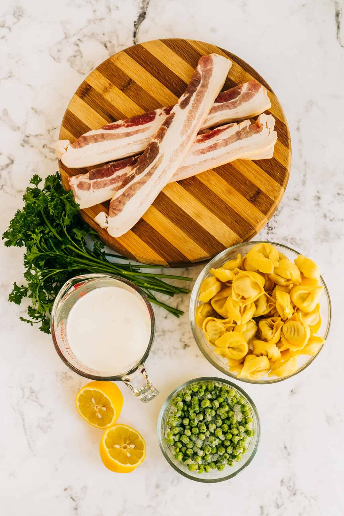 Overhead view of ingredients needed for bacon carbonara